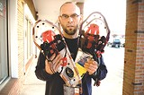 PHOTO BY JEFFREY MARINI - Medved's Mort Nace shows off some modern snowshoes; the Rochester area is home to several annual competitive snowshoeing events