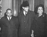 ALL PHOTOS COURTESY FRANKLIN FLORENCE PAPERS, DEPARTMENT OF RARE BOOKS & SPECIAL COLLECTIONS, UNIVERSITY OF ROCHESTER LIBRARY. - Minister Franklin Florence (left) and Constance Mitchell (right) are pictured with Malcolm.