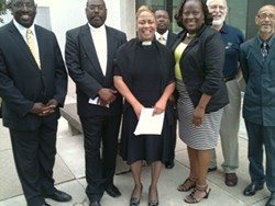 Pastor Shirley Billups-Bell (center) with her supporters at a press conference this morning. - PHOTO BY TIM LOUIS MACALUSO