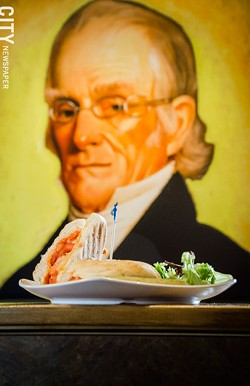 Nathaniel Rochester looks over a five cheese and tomato panini, served with a side salad. - PHOTO BY MARK CHAMBERLIN
