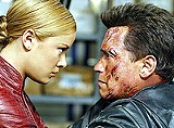 WARNER BROS. - Obsolete cyborg: Arnold Schwarzenegger battles Kristanna Loken