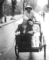 "On a slow cart to Saigon: Michael Caine in ""The Quiet American."""