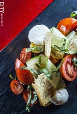 Organic Tomato Salad with cherry tomato, mozzarella espuma, broken balsamic vinaigrette, and baguette tuile - PHOTO BY MARK CHAMBERLIN