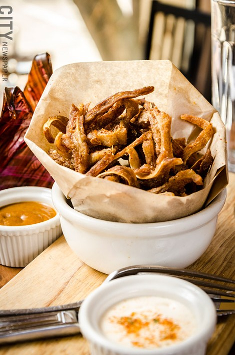 Ox and Stone incorporates flavors from Spain and Latin influences, which can be seen in the crispy pig ears with blackstrap rum bbq sauce and mojo aioli. - PHOTO BY MARK CHAMBERLIN