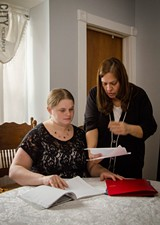 Parent Sarah Johns (left) with Parents as Advocates instructor Susan Hall. - PHOTO BY MARK CHAMBERLIN