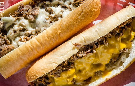 Philly Steak sandwiches on Amoroso rolls with cheese - PHOTO BY MARK CHAMBERLIN