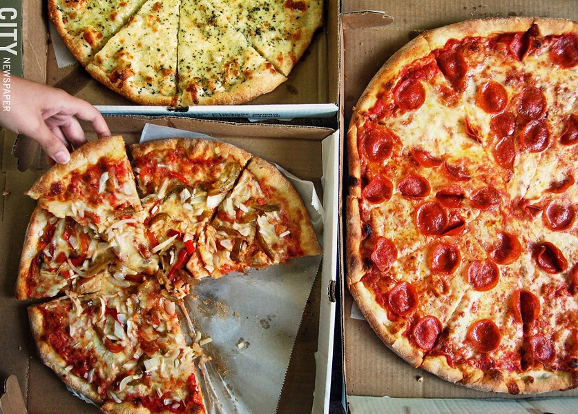 Pick up a slice from The Pizza Stop. - FILE PHOTO