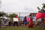 PHOTO BY MATT BURKHARTT - Protestors march Saturday against Operation Save America. The national anti-abortion group held its yearly big event in Rochester. OSA is also known to oppose homosexuality and Islam, according to the Anti-Defamation League.
