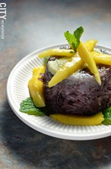 Purple rice dessert with sweet custard and mango. - PHOTO BY MATT DETURCK
