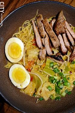 Ramen with pork-bone broth, noodles, roasted pork, scallions, and egg from Furoshiki on Park Avenue. - PHOTO BY MATT DETURCK