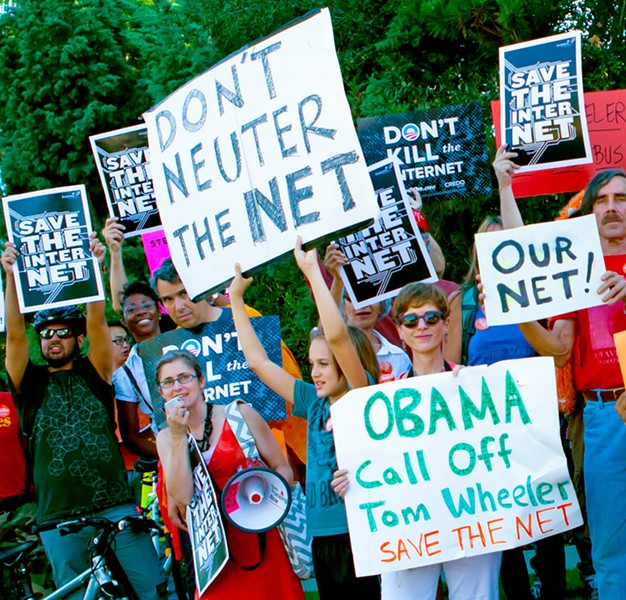 (right) Under the FCC's proposed new rules, corporate giants such as Comcast could charge entities to use faster bandwidth. Here, activists in Los Angeles rally for net neutrality. PHOTO BY STACIE ISABELLA TURK/RIBBONHEAD (VIA FLICKR)
