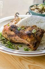 Roast chicken with rosemary, scallions, and rice from La Marifinga.