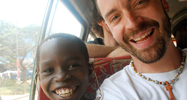 Rochester musician Jesse Sprinkle (right) has been traveling to Uganda helping empower African children through music.