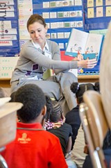 Rochester Young Professionals member Pamela Smith reads to kids as part of a volunteer activity. - PHOTO BY MARK CHAMBERLIN