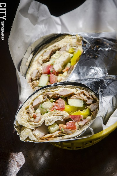 Sabra Grill features a deep menu of Moroccan and Israeli dishes, including the shwarma in a laffa wrap. - PHOTO BY MARK CHAMBERLIN