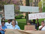 PHOTO BY JENNIFER WEISS - Save our Swasey! Colgate students and faculty protest the book swap.