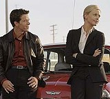 PARAMOUNT PICTURES - Sexy machines: Mark Wahlberg and Charlize Theron in 'The Italian Job.'