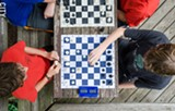 PHOTO BY MARK CHAMBERLIN - Six young men at Wilson Foundation Academy make up a competitive chess team. They've been playing together since kindergarten and have won state and national tournaments.