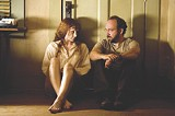 "WARNER BROS. - Slip and slide: Bryce Dallas Howard and Paul Giamatti in M. Night Shyamalan's - ""Lady in the Water."""