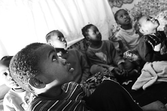 Somali children living on and around Vanauker Street congregate in Abdurahim Mukumbira's living room. - GARY VENTURA