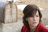 "WARNER BROS. PICTURES - Stamp of approval: Despite the weird time-hopping - plot, Sandra Bullock and ""The Lake House"" score a thumb's up."