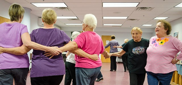 Students in an Oasis tap-dancing class rehearse for a performance.
