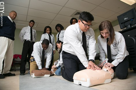 Students Teodoro Santiago and Melissa Calkins practice CPR during class. - PHOTO BY MIKE HANLON