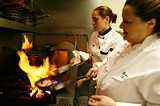 PHOTOS BY GARY VENTURA - Subtle Italian for the seasons: chefs Katie Lombardo and Sylvia Formoso on the Lucano kitchen.