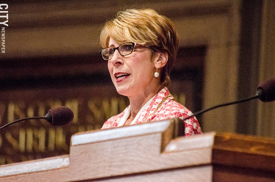 Sue Cotroneo, managing director of Rochester Lyric Opera, announces plans to convert a former East Avenue church into a performance hall. - PHOTO BY MARK CHAMBERLIN
