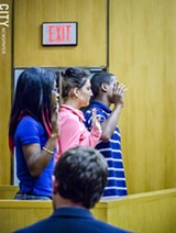 Teen jurors are sworn in before hearing a case. - PHOTO BY MARK CHAMBERLIN