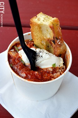 The Meatball Truck Co. meatballs in a cup with bread. - PHOTO BY MATT DETURCK