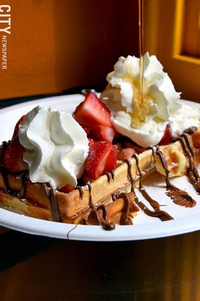 "The ""Mr. Popular"" waffle (fresh fruit, whipped cream, Nutella, maple syrup) from Waffle Frolic. - PHOTO BY MATT DETURCK"