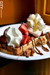 "The ""Mr. Popular"" waffle (fresh fruit, whipped cream, Nutella, maple syrup) from Waffle Frolic."