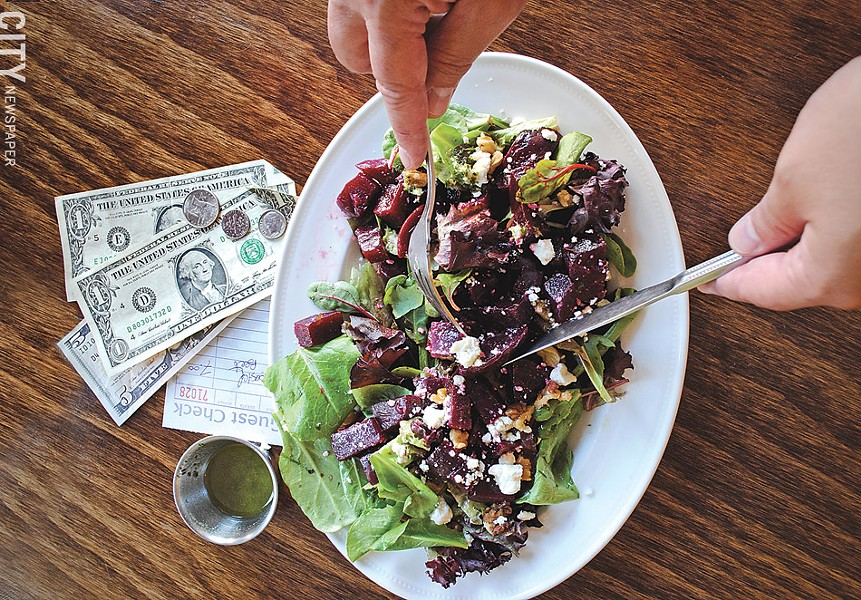 The roasted and marinated red beets — served over mixed greens and topped with an herb vinaigrette, walnuts, and goat cheese — at Mise en Place. - PHOTO BY MATT DETURCK