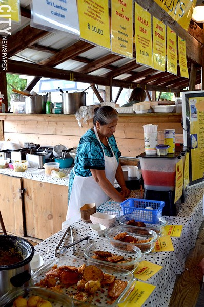 "The Sri-Lankan ""Curry in a Hurry"" stand at the Ithaca Farmers' Market. - PHOTO BY MATT DETURCK"