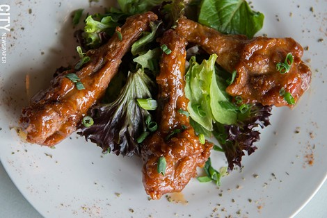 The sweet-and-sour duck-wing appetizer from Roam Cafe. - PHOTO BY THOMAS J. DOOLEY
