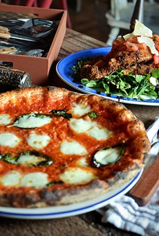 The wood-burning oven at Buffalo Road's Fiamma can cook a pizza to perfection in just 45 seconds. (Left) Margherita pizza. (Right) Pollo capriccioso