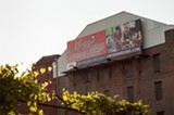 PHOTO BY JEREMY MOULE - This billboard, visible from I-490, was part of a local union's effort to put pressure on the county during contract negotiations.