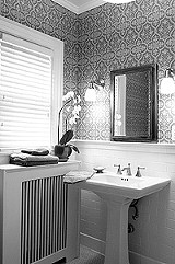 KURT BROWNELL - This water-damaged bathroom got new plaster, period-appropriate subway tile, and luxury in the form of a sauna.