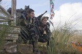 """PHOTO COURTESY WARNER BROS. PICTURES - Tom Cruise and Emily Blunt in """"Edge ofTomorrow."""""""