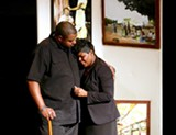 "PHOTO BY ANNETTE DRAGON - Tremell Hale puts his arm around Deborah Solomon in a scene from ""Project Baldwin."" The production, featuring the North Star Players, will be a part of the first Bronze Collective Theatre Fest."