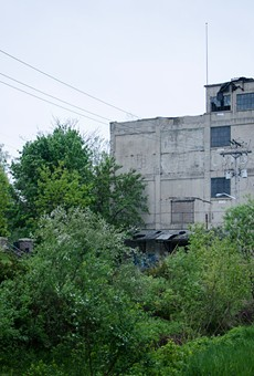 A vacant, dilapidated building at the end of Flint Street marks the Vacuum Oil site.