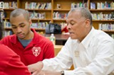 PHOTO BY MARK CHAMBERLIN - Ty Kelly (right), Wegmans' director of youth services, works with student Joshua Salters.