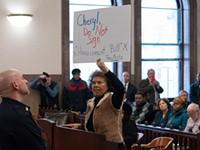 Dozens of speakers blast harassment law