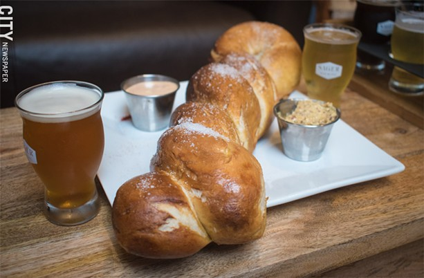 Perfect to pair with any brew: the enormous soft pretzel at Sager Beer Works. - PHOTO BY JACOB WALSH