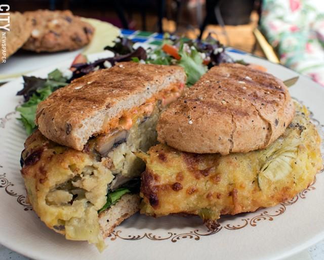 Mushroom artichoke burger and mixed field greens at Orange Glory Café. - PHOTO BY RENÉE HEININGER