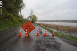 During the 2017 Lake Ontario Flooding, South Bay Front Lane was closed as waters from Irondequoit Bay crept over it. - FILE PHOTO