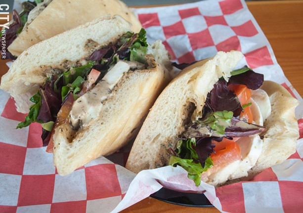 The Caprese sub at TinRoof Bar & Grill is a hearty sandwich, drizzled with balsamic vinegar and pesto. - PHOTO BY JACOB WALSH