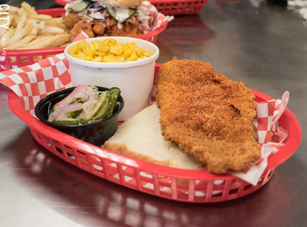 The (off-menu) fried catfish with cucumber tangy onion salad and corn sides. - PHOTO BY JACOB WALSH