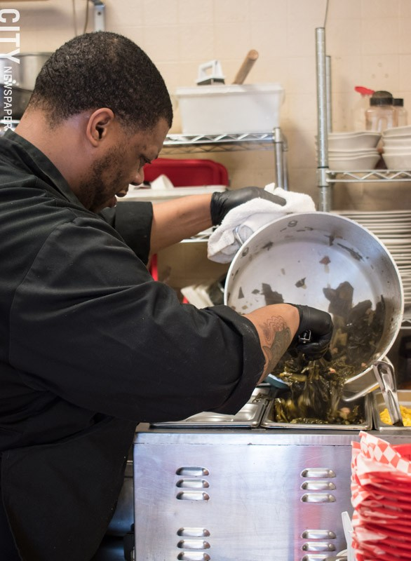 Chick'N Out cook Kevin Stevens prepares collards at Blossom Road Pub. - PHOTO BY JACOB WALSH